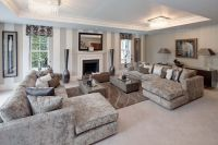 Formal Living Room with detailed coffer ceiling and taupe ...