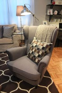 The IKEA STRANDMON wing chair is a comfortable piece with ...
