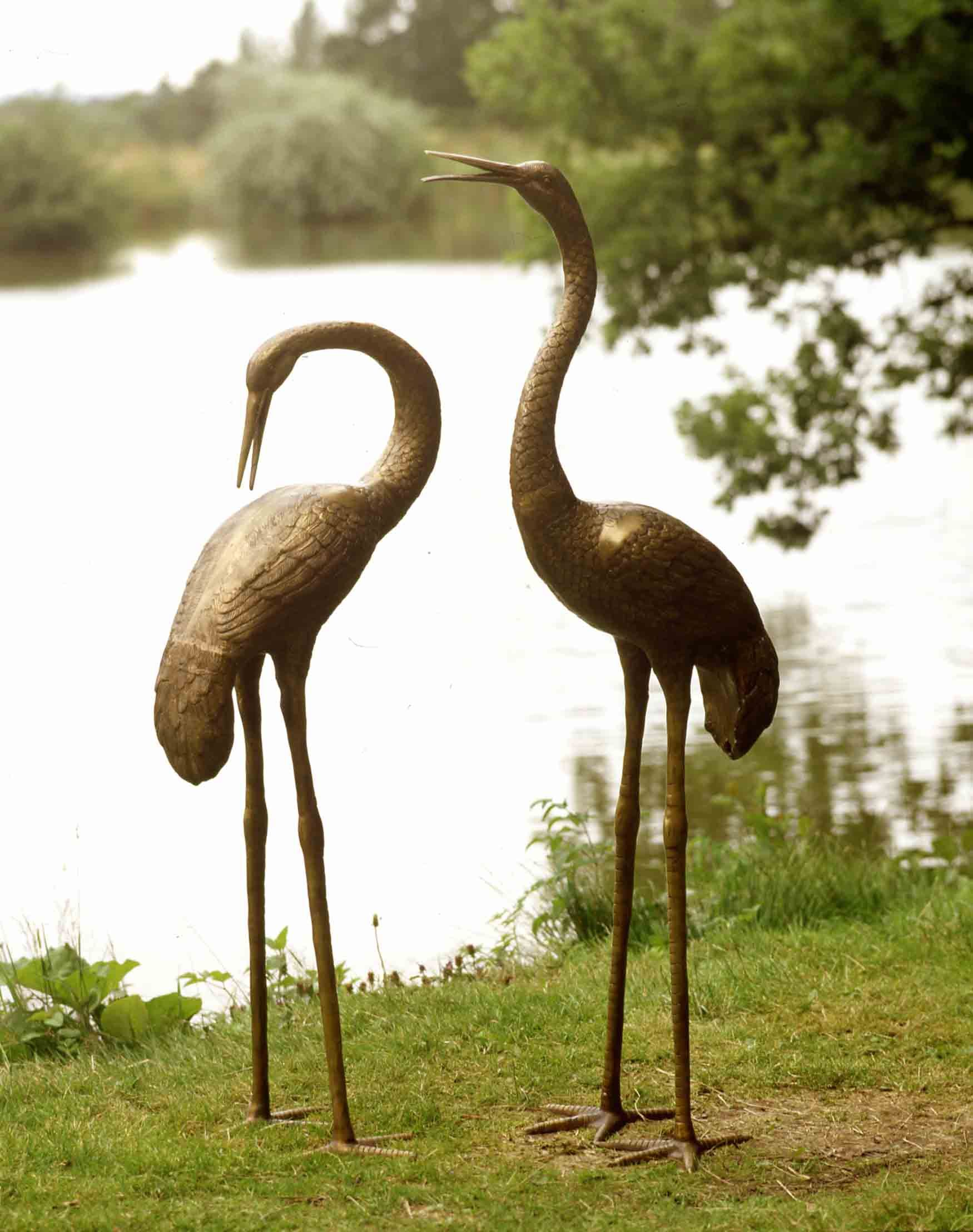 Large brass crane statuary and ornaments