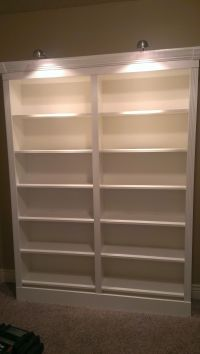 They're done! Ikea Billy bookshelves dressed up with base ...