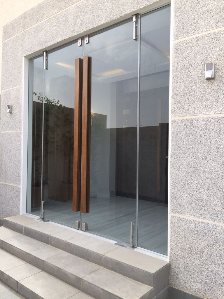 Glass door with wooden handle