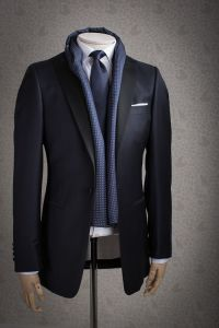 Blue textured silk scarf paired with suit, tie, and pocket ...