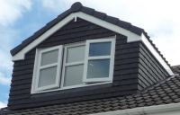 a wide single pitched roof dormer, with triple pane ...