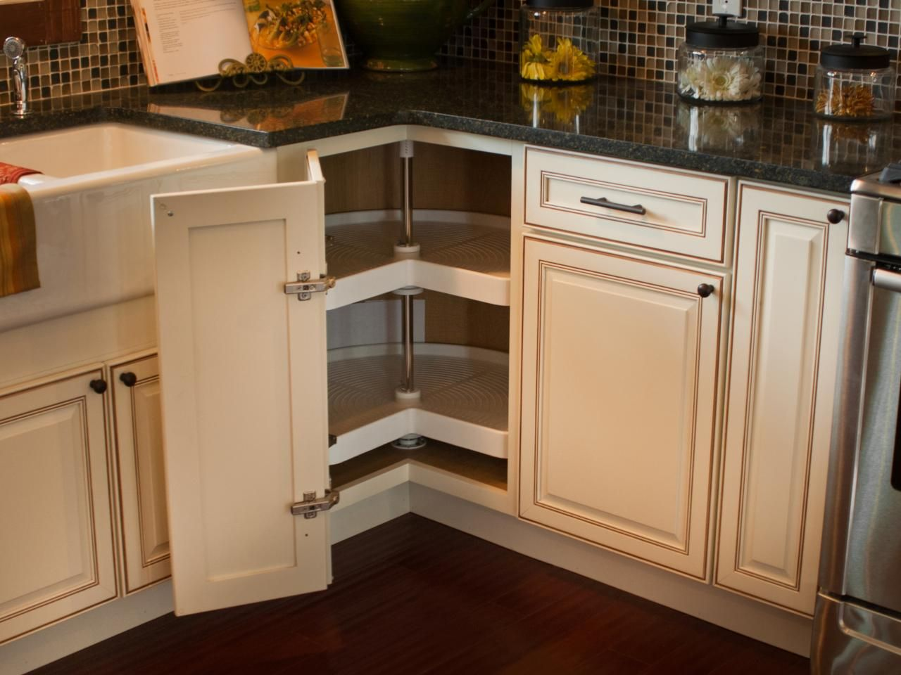 Kitchen Cabinets Lazy Susan Corner Cabinet A Corner Cabinet Door Opens To Reveal A Kidney Shaped Lazy