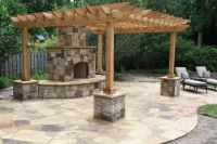 Flagstone Patio with Outdoor Fireplace and Pergola with ...