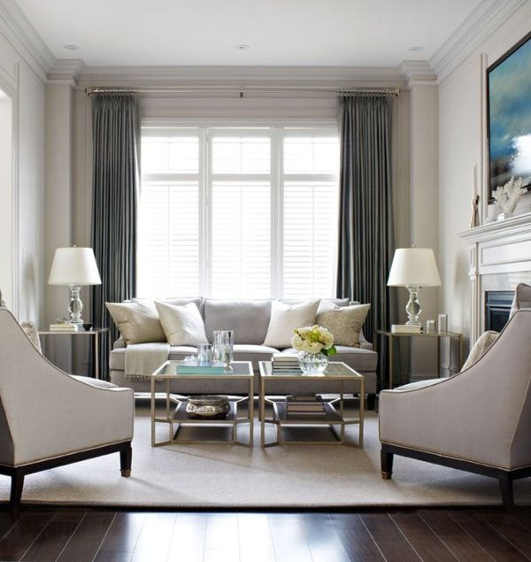 Elegant living room, with light grey sofa and arm chairs with - elegant living rooms