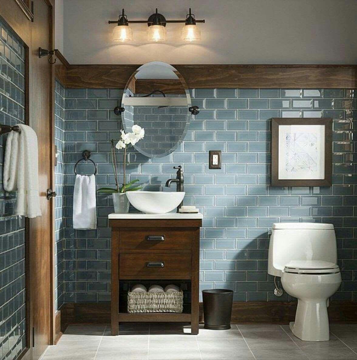 Rustic and modern bathroom blue grey glass tiles