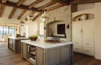 Mediterranean kitchen features a vaulted ceiling lined ...