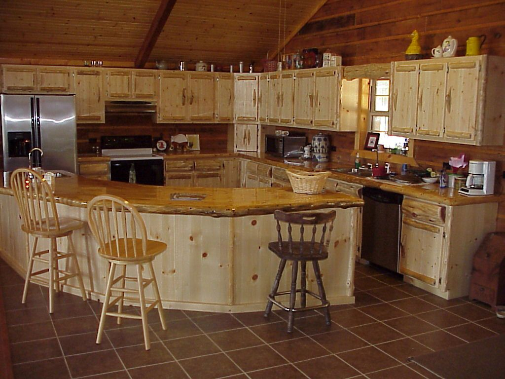 Log home kitchen cabinets boxes euro style drawer slides and log trim give our