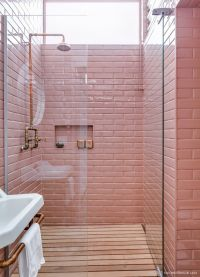 pink subway tile outdoor shower with copper plumbing and ...