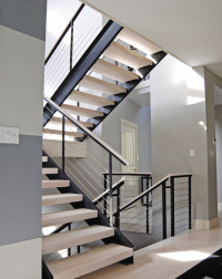 Extensive modern staircase with cable railing by Stainless ...