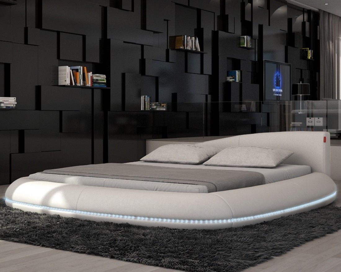 Splendid bedroom furniture designs ideas with white round floor beds in futuristic bedroom design