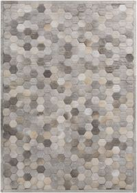 Piece by piece, this leather geometric rug design is ...