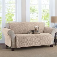 This deluxe quilted, fleece-like sofa cover is designed to ...