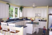pictures of kitchens with yellow walls, white cabinets and ...