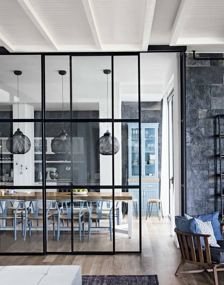 Gorgeous floor to ceiling glass divider between kitchen