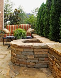 Half Circle Stacked Stone Firepit with Attached Seating ...