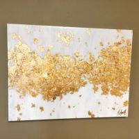 This item is an acrylic painting with gold leaf accents ...