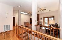 modern open stairway between kitchen and living room ...