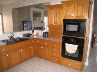Grey Dark Granite Countertops With Oak Cabinets With Black