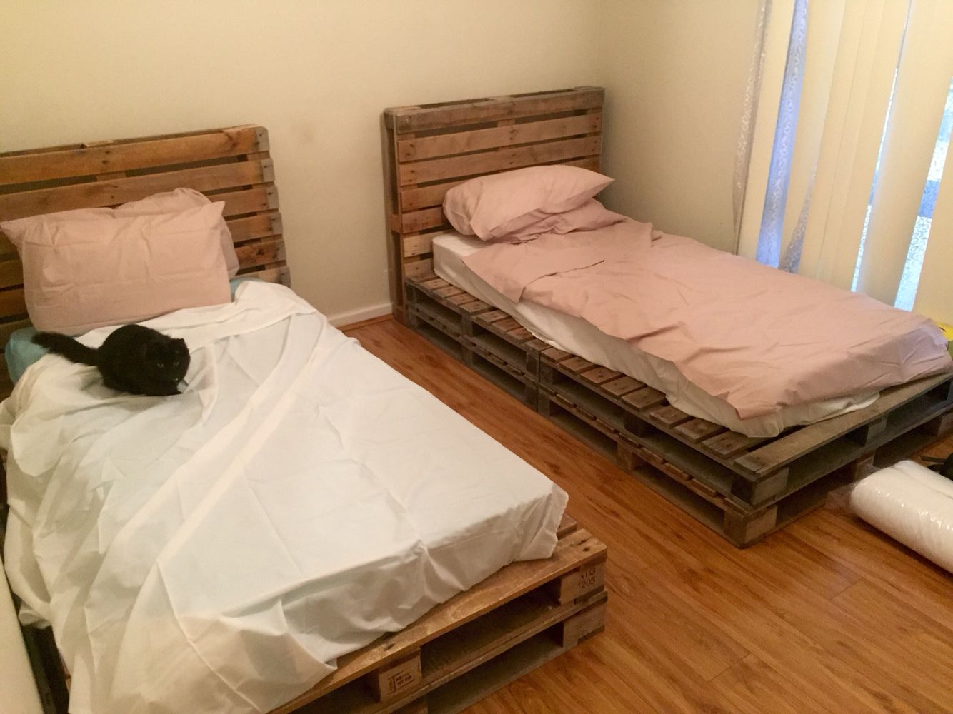 Wooden pallet single beds