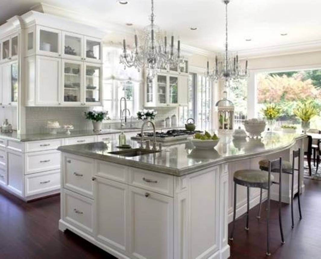 white kitchen cabinet ideas Stunning white transitional kitchen with brass chandeliers faucets pot filler and handles Two toned La Cornue stove Kitchens Pinterest Lighting