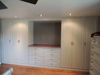 Custom white wall unit in a master bedroom