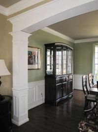 Dining Room with custom millwork archway, chair rail and ...