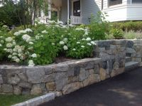 landscape design with retaining wall