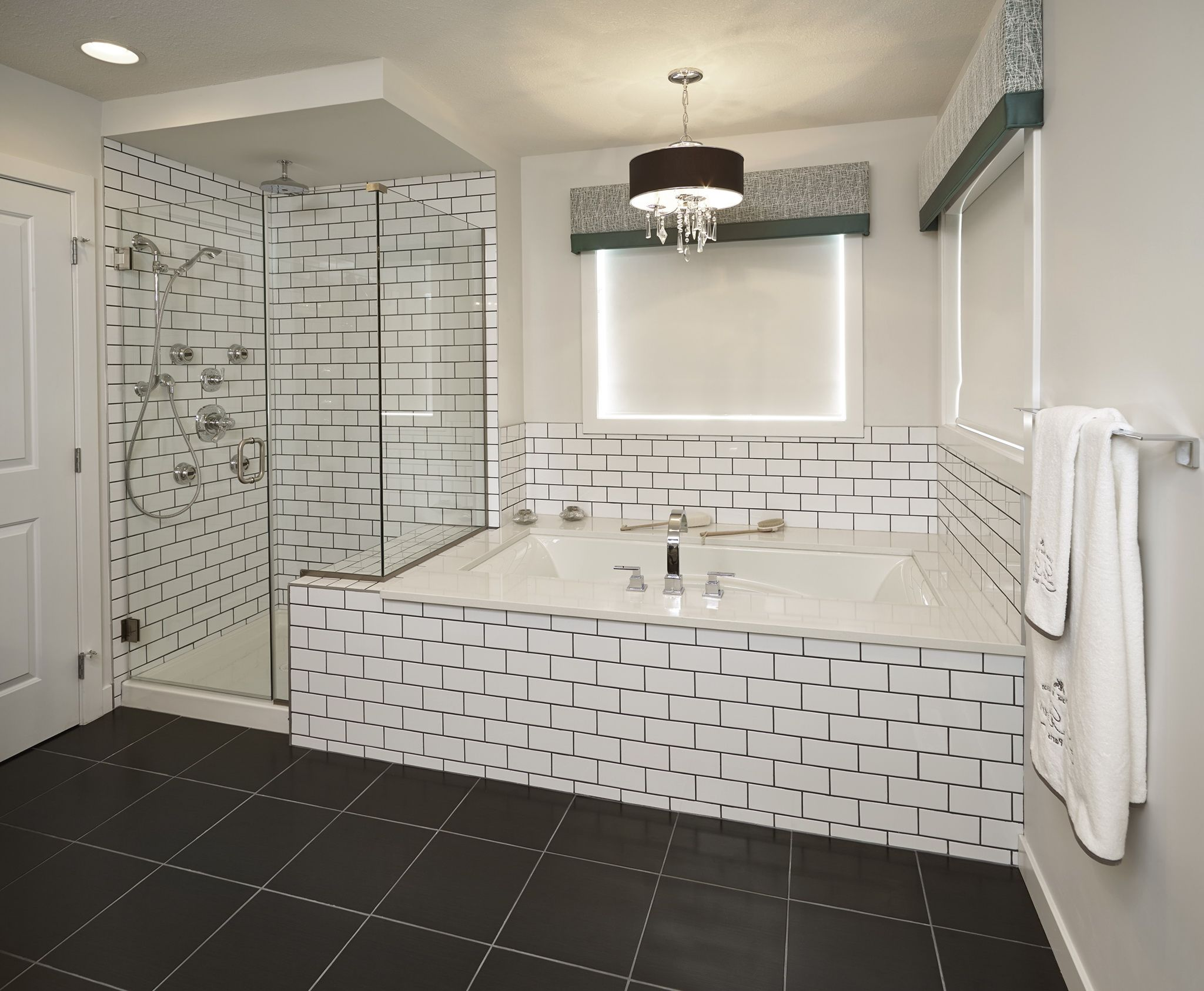 Subway tile bathroom black grout