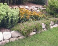dry stack boulder rock flower bed | river rock stone wall ...