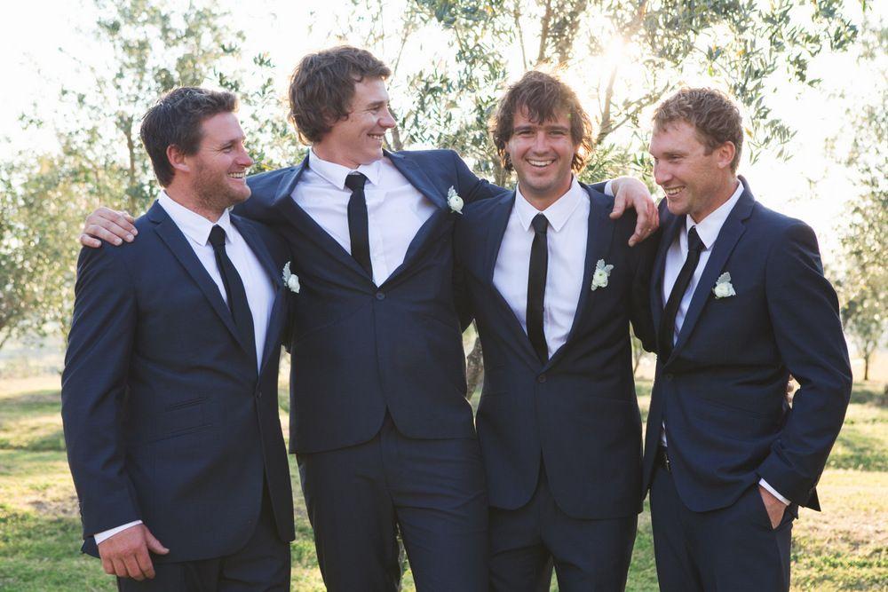 Navy blue groomsmen suits with black skinny tie
