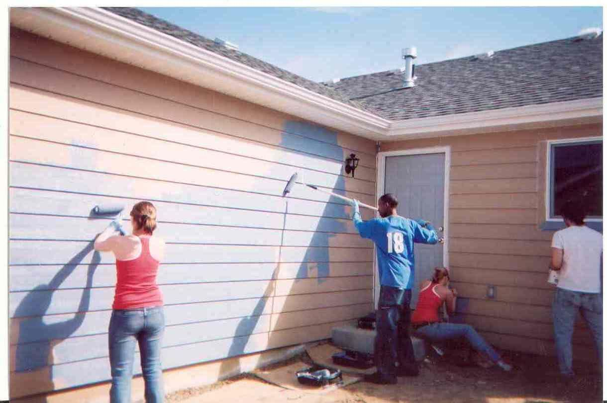 People painting house exterior