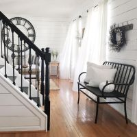 Beautiful farmhouse country entryway with black stair ...