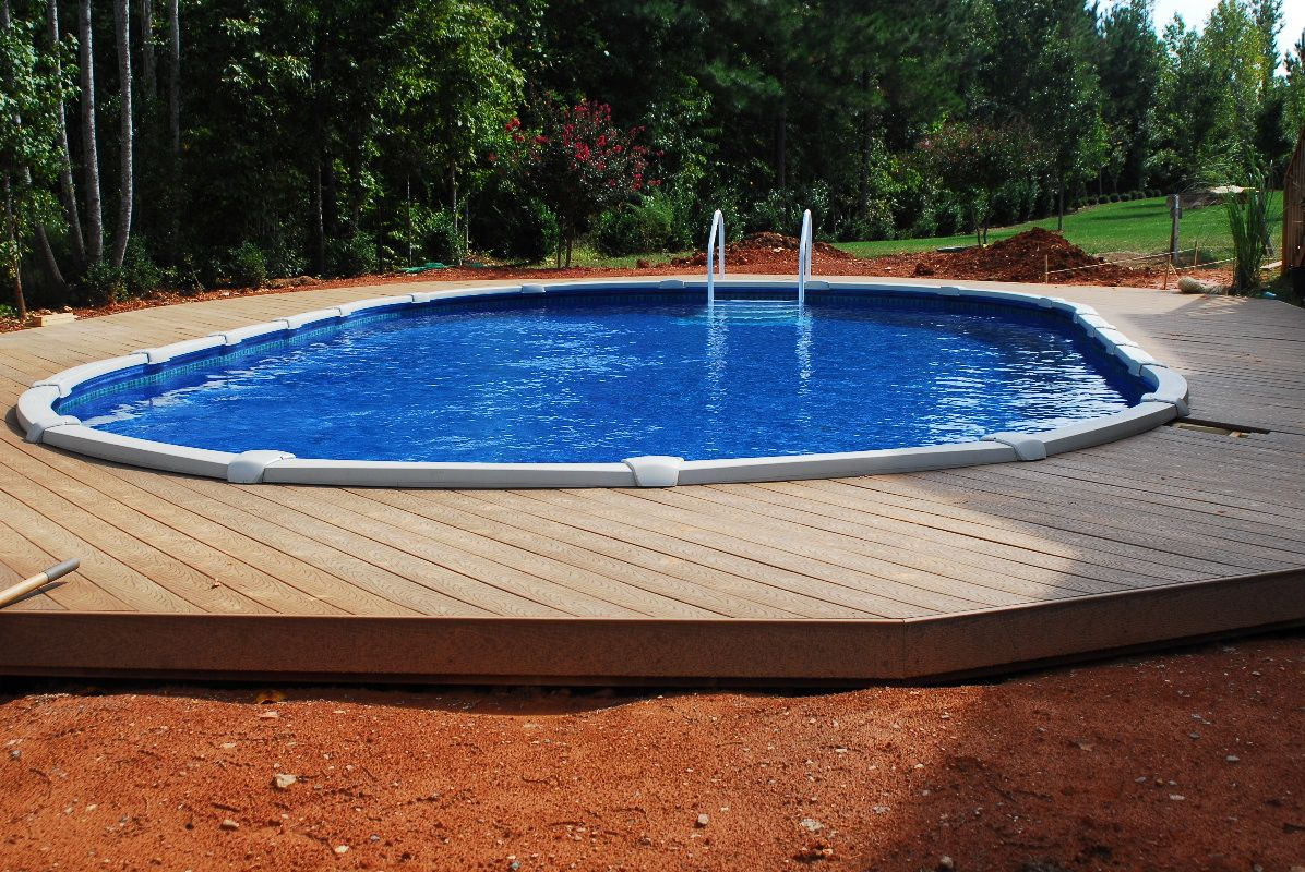 Jacuzzi Oval Pool Above Ground Built Into Ground With Wooden Deck Http