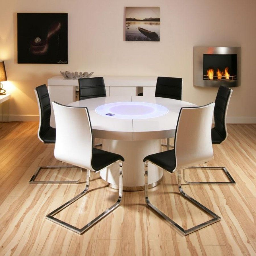 white round kitchen table Large round white gloss dining table and six white black dining chairs Truly stunning