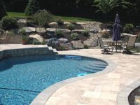 Pool with Boulder retaining wall | Backyard landscaping ...