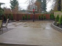 The concrete slab basketball court is great exercise for ...
