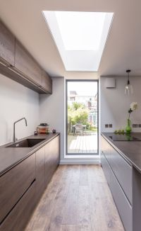 Modern kitchen extension | sleek design | framed garden ...