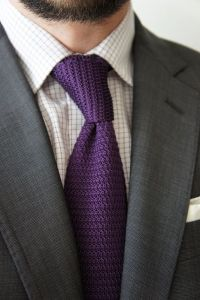 Grey suit, white shirt with black check, purple knit tie ...