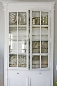 Vintage white cabinet with glass doors for linen storage ...