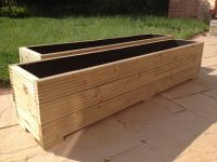 Large wooden garden planter trough in decking boards ...