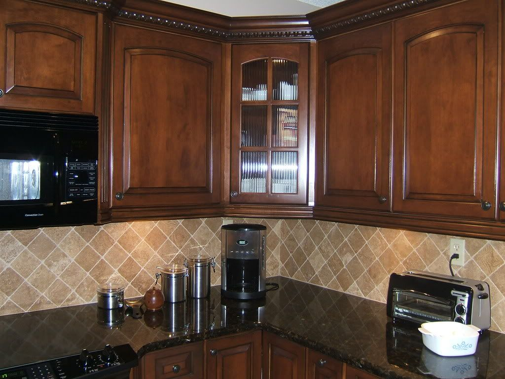 Oak Cabinets Backsplash Light Colored Oak Cabinets With Granite Countertop Here