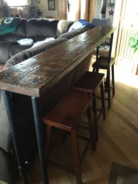 Behind the couch bar top. 1 inch pipe and 2X12 stained ...