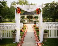 garden gazebo wedding ceremony aisle tulle flowers fabric ...