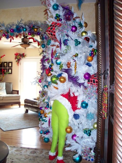 Stuff green tights full of pillow stuffing and shove him in your - dr seuss christmas decorations