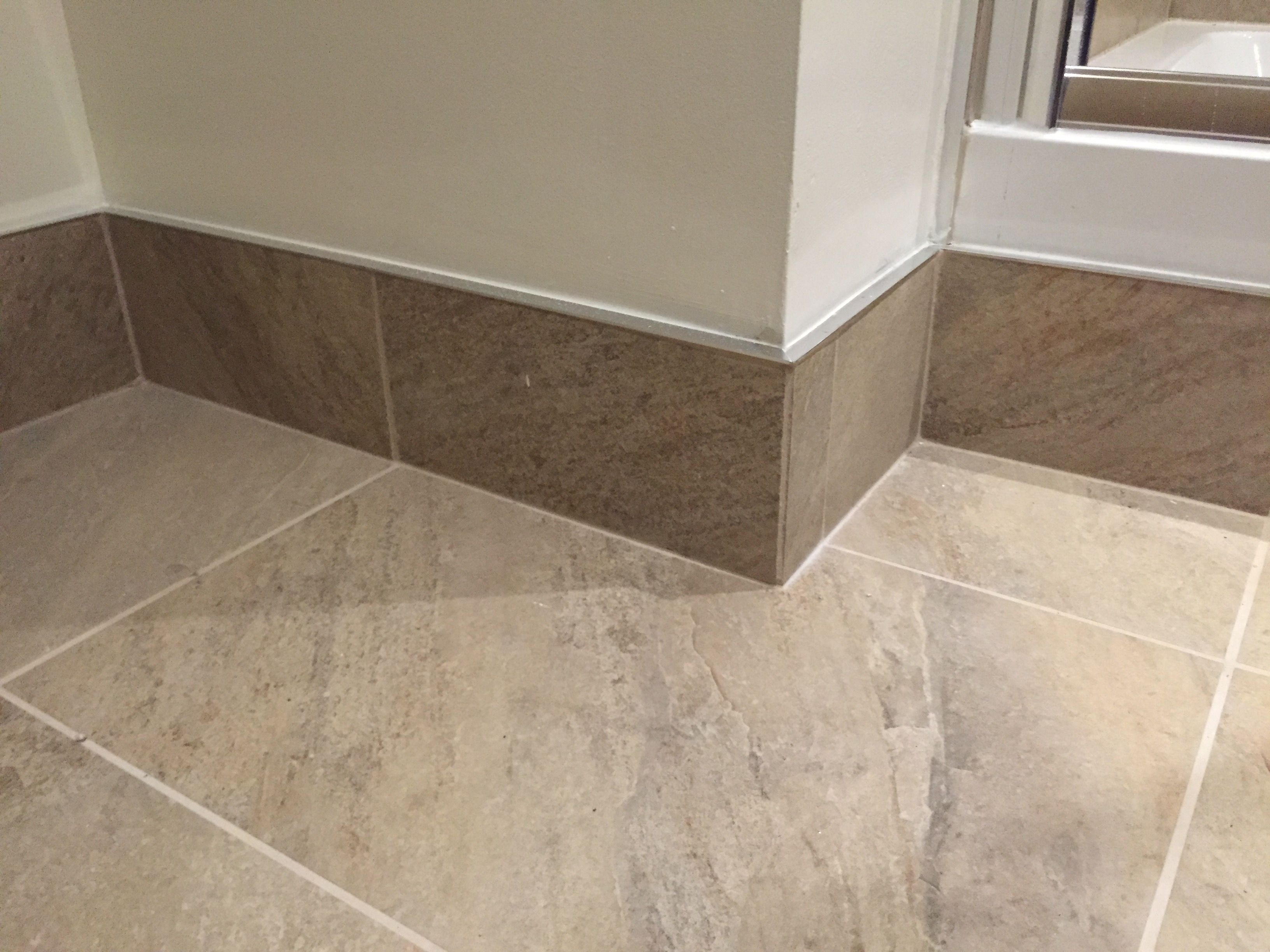 Tiled skirting board with chrome trim