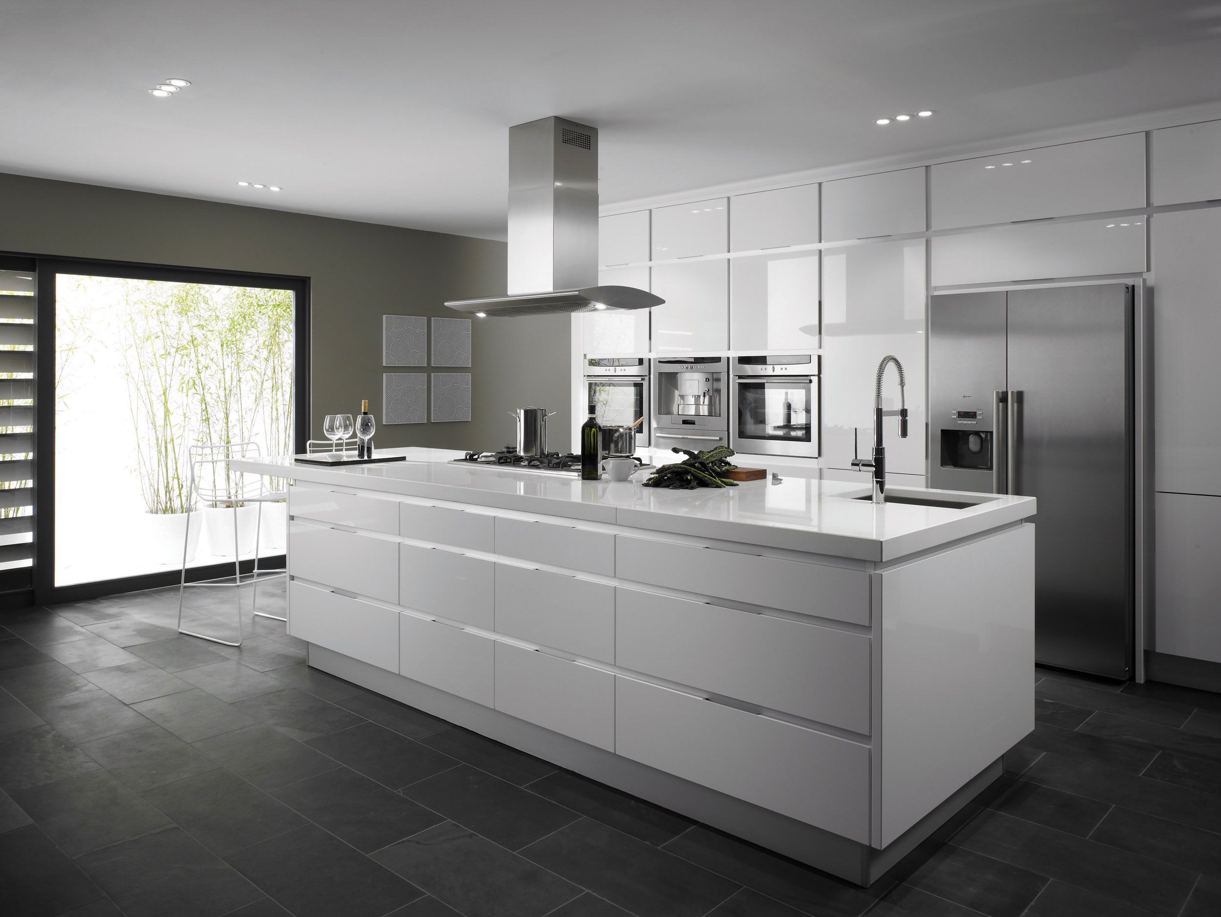 white kitchen dark floors Kitchen Decoration Fashionable Chrome Free Standing Range Hood Dark Tiles Kitchen FloorsModern White