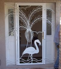 Ornamental iron screen door with flamingo and palm tree ...