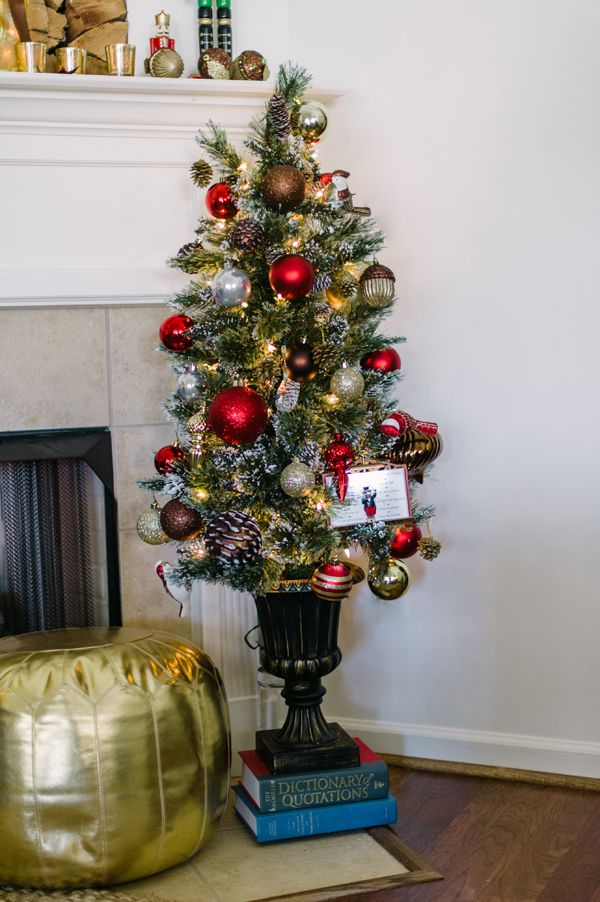 Flank the fireplace mantel with a small 45 ft Christmas tree - small decorative christmas trees